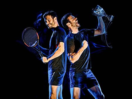 one caucasian Tennis player man studio shot isolated on black background with light painting blur effect 写真素材