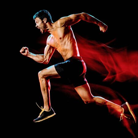 one caucasian topless muscular mature man runner. running jogger jogging isolated on black background with light painting speed movement effect Banco de Imagens