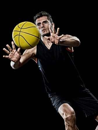one caucasian young basketball player man in studio isolated on black background 스톡 콘텐츠
