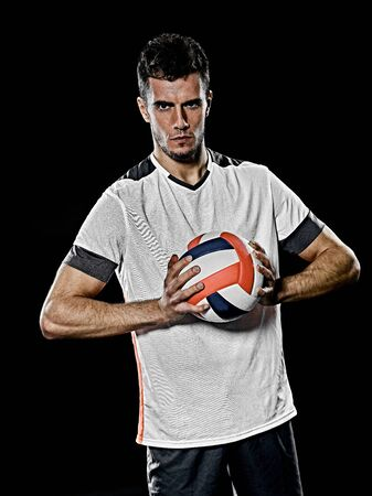 one caucasian young volley ball player man in studio isolated on black background