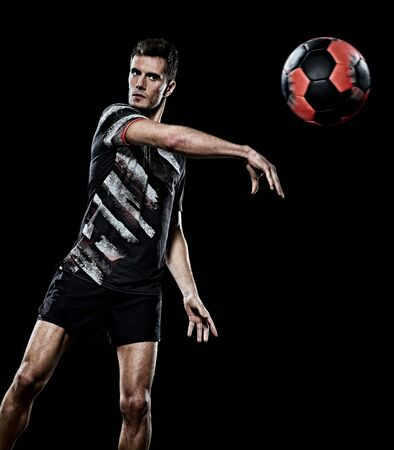 one caucasian young handball player man in studio isolated on black background