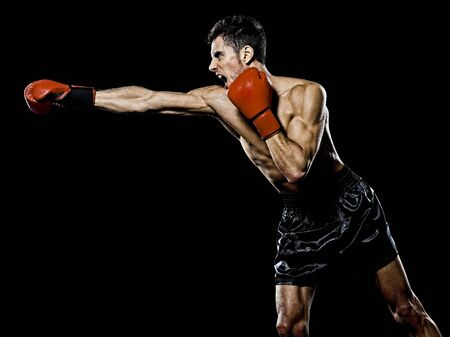one caucasian young man boxer boxing profile side view in studio isolated on black background 스톡 콘텐츠