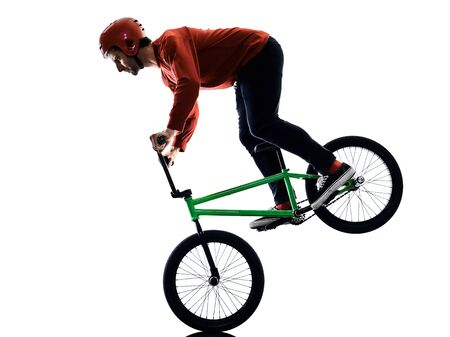 one young caucasian man BMX rider cyclist cycling freestyle acrobatic stunt in studio isolated on white background Stockfoto