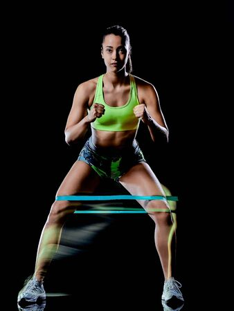 woman exercising fitness exercises isolated black background lightpainting effect 版權商用圖片