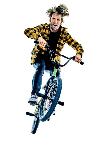 BMX rider cyclist cycling freestyle acrobatic stunt isolated white background Banco de Imagens