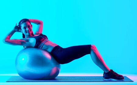 woman exercsing fitness pilates exercices isolated 写真素材
