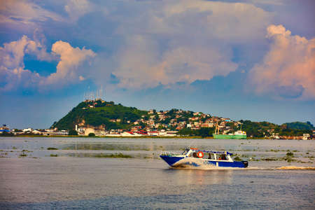 Guayaquil , Ecuador- March 7 , 2020 : shuttle boat taxi on the Guayaquil river at sunset Stock Photo - 150995128