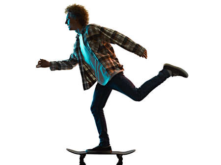 young man skateboarder Skateboarding isolated white background shadow silhouette 免版税图像