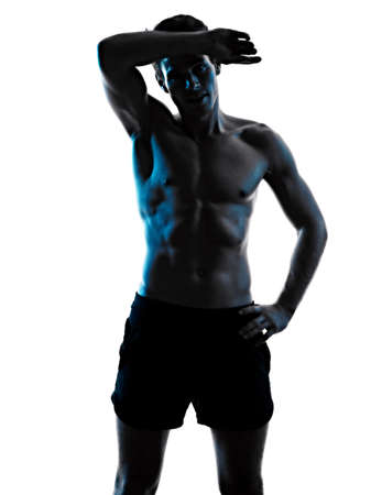 young man fitness exercise exercIsing shadow isolated white background silhouette Foto de archivo