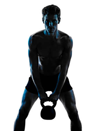 man fitness Kettle Bell exercise shadow isolated white background silhouette Imagens