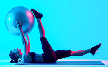 woman exercsing fitness pilates exercices isolated Imagens