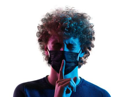 young man headshot face mask hushing silence portrait shadow white background