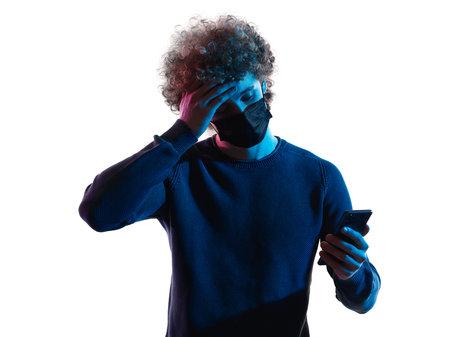 young man headshot face mask portrait shadow white background telephone sick