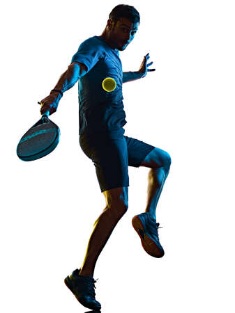 mature man Paddle Padel player shadow silhouette isolated white background Imagens