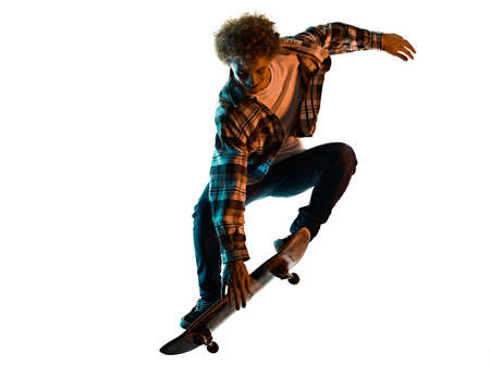 young man skateboarder Skateboarding isolated white background shadow silhouette Imagens