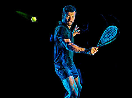 Paddle tennis player man light painting isolated black background Imagens