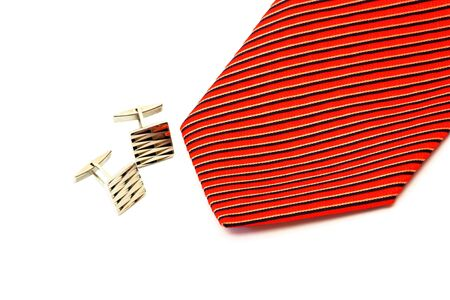Cufflinks Button shirts in Focus cufflinks and a red tie photo