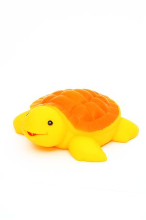 Turtle, yellow, red, orange, smile, eyes, carapace, legs, rowing, sailing, diving  Turtle toy rubber bath Stock Photo