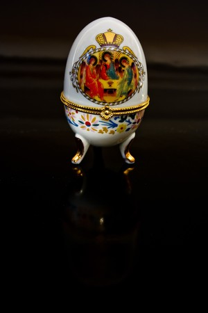Jewellery egg with an icon on a black background Stock Photo - 7661211