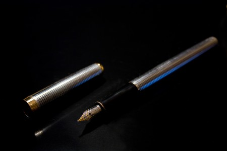 A steel pen with gold Stock Photo - 7661178