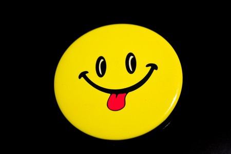 sign face smile black background language photo