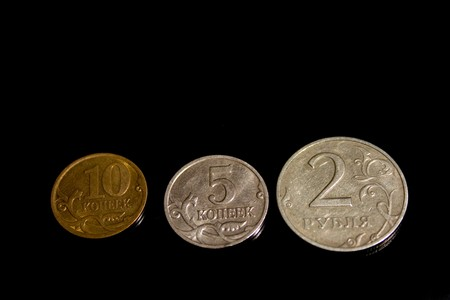 Ruble, penny, coin, three on a black background photo
