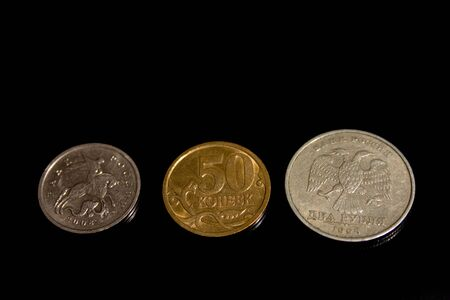 Ruble, penny, coin, three on a black background herb photo