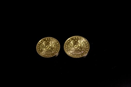 Kazakhstan Tenge KZT one and two on a black background photo