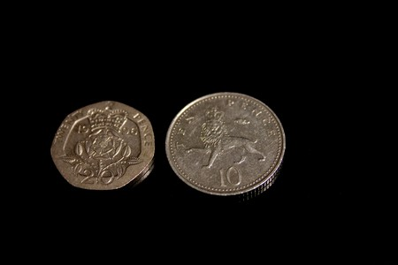 10 and 20 pence per person Queen on a black background photo