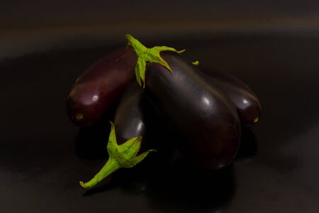 With eggplant on a dark reflective background black Stock Photo