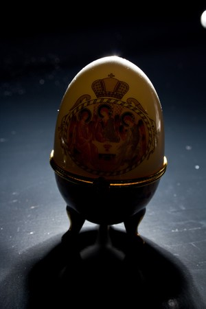 Jewellery egg with an icon on a black background Stock Photo