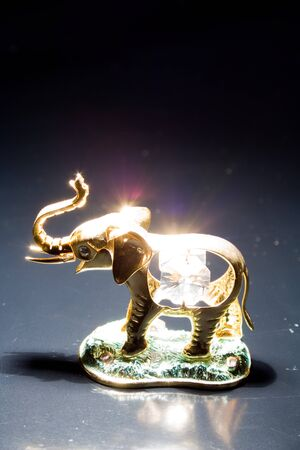 sculpture: Jewellery gold statuette elephant crystals on a black background