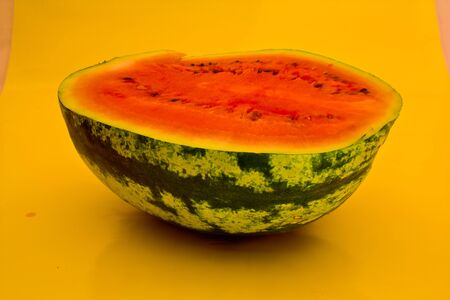 watermelon in half term on a yellow background Stock Photo
