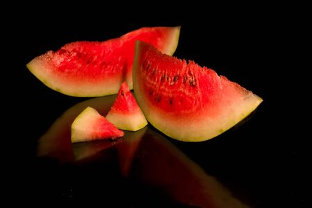 Several groups slice of watermelon slice on a black background