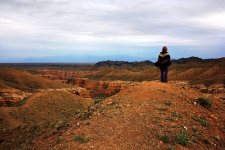 The woman on the verge of a canyon photo