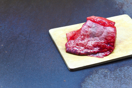 Raw meat on metal background, top view, border
