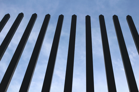 insurmountable: Jail. Strong fencing. background blue sky Stock Photo
