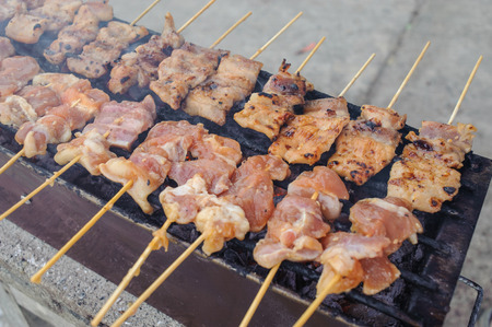 chinese food: grilling pork in local market at Thailand