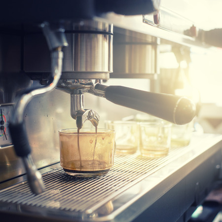 making coffee: Espresso machine brewing a coffee in coffeeshop Stock Photo