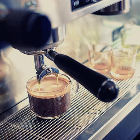 espresso machine: Espresso machine brewing a coffee in coffeeshop Stock Photo