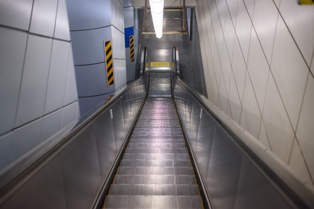 long way: The long way escalator  Escalator in underground building Stock Photo