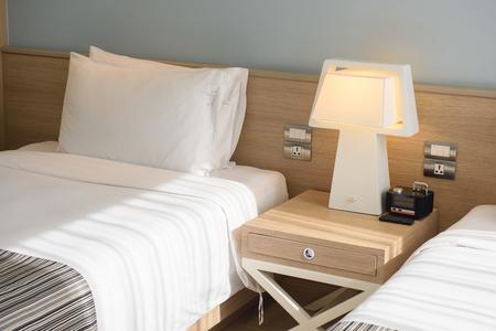 luxury bedroom: Pillow bed in luxury hotel bedroom Stock Photo