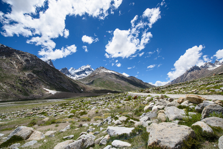 moutains: road to moutains with clouds in blue sky Stock Photo
