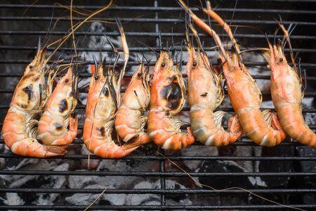 flaming: Grilled shrimps on the flaming grill. Stock Photo
