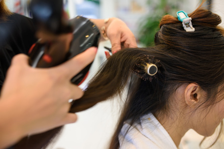 hair stylist: Hands of professional hair stylist Stock Photo