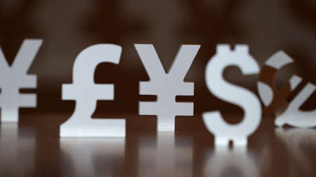 home value: Euro, yen, pound sterling and dollar symbols
