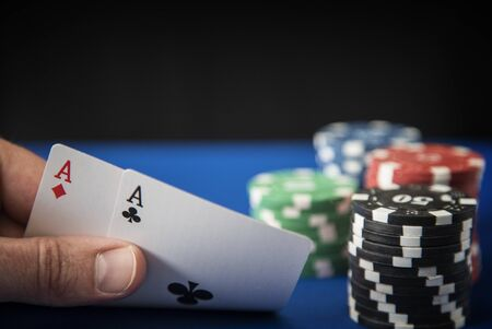 gambling counter: Gambling chips and poker cards in casino Stock Photo