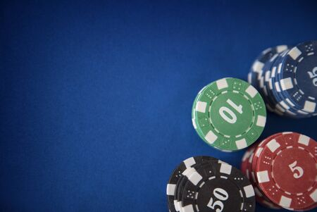gambling counter: Gambling chips on poker table in casino