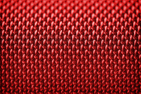 mechanical radiator: Audio speakers red cover - macro shot for background Stock Photo