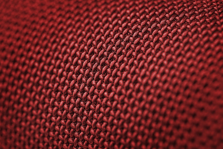 Audio speakers red wicker cover - macro shot for background